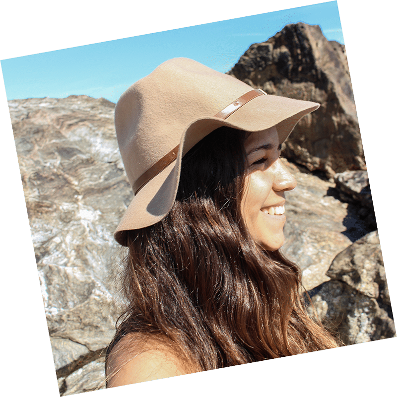 Selene with a hat at the beach of Porto, Portugal
