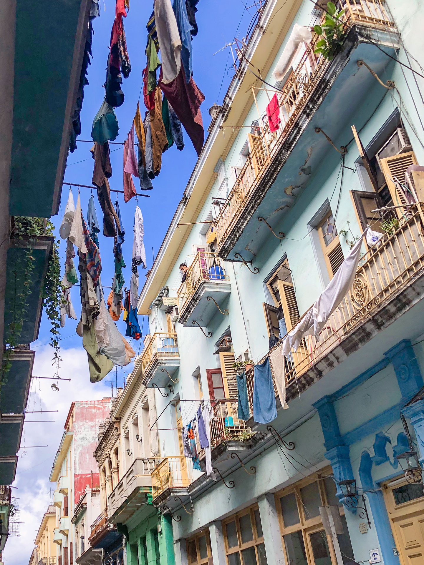 Pictures of the hanging clothes and picturesque buildings in Havana, Cuba