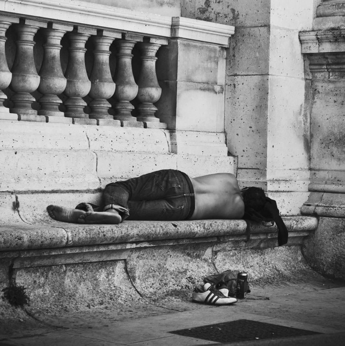 Homeless sleeping in front of the Louvre in Paris, France