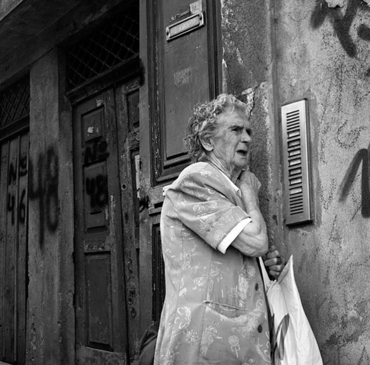 Elderly woman on the streets of Porto, Portugal