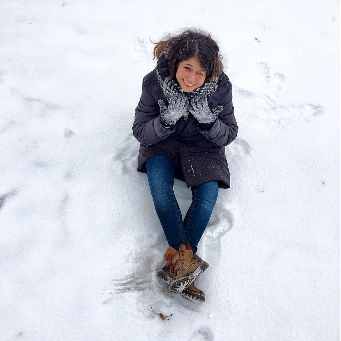 Selene playing with the snow in Moscow, Russia on winter time