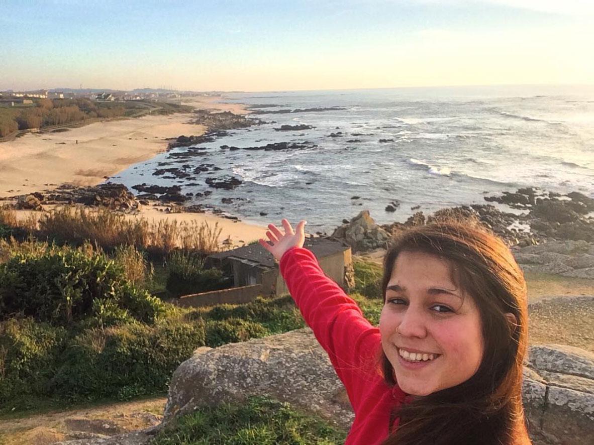 Selene pointing at the horizon in Vila Cha, portugal