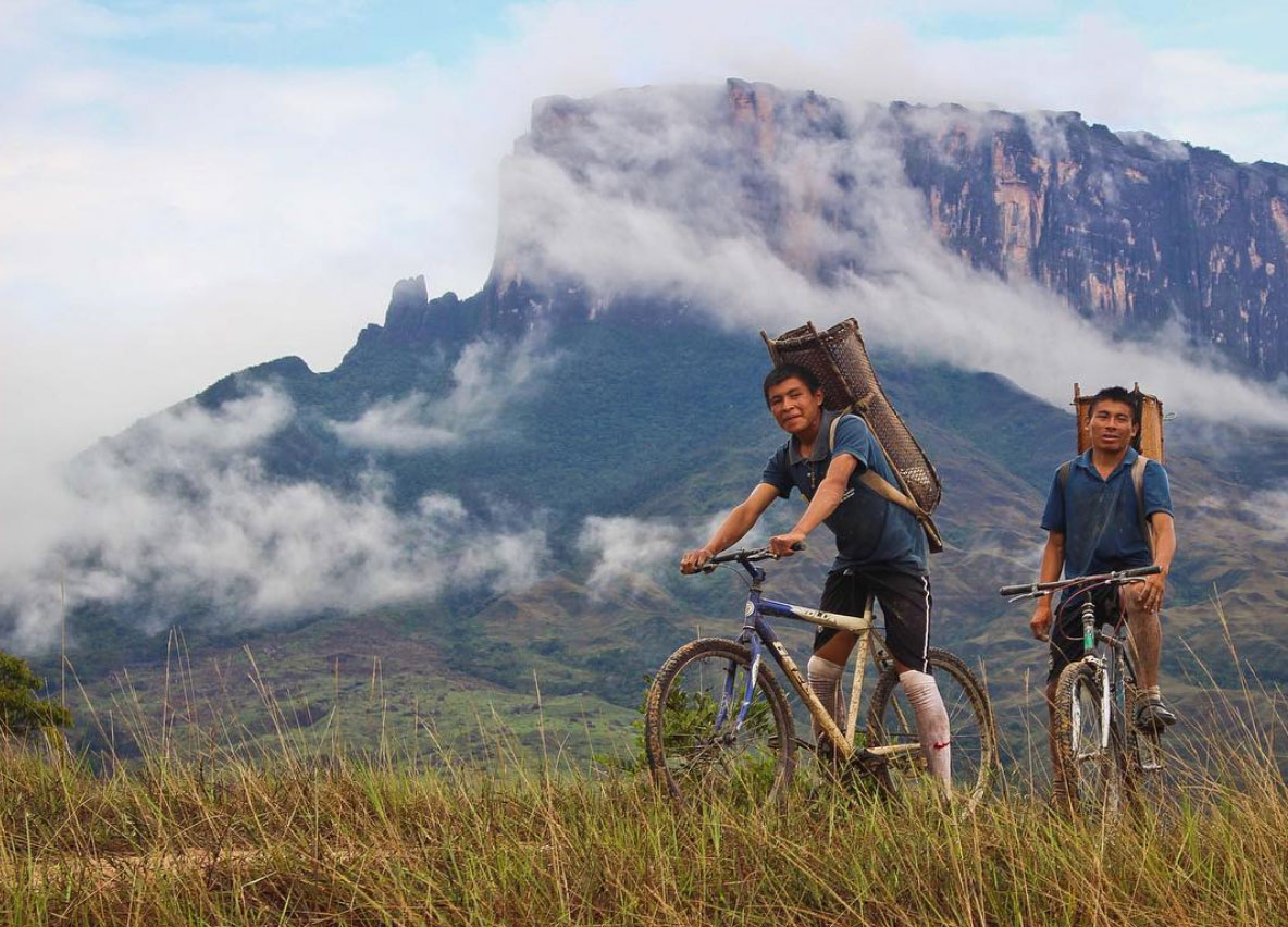 Two natives on their bicycles at the Roraima, Venezuela