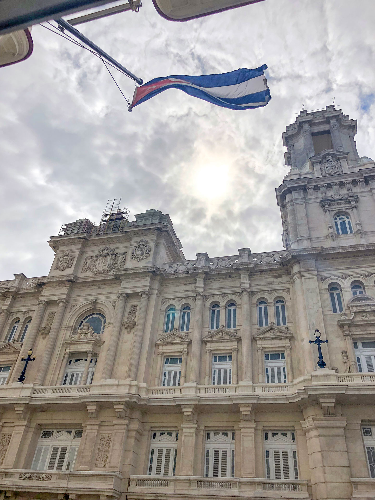 Picture of a classic building with the Cuban flag in Havana