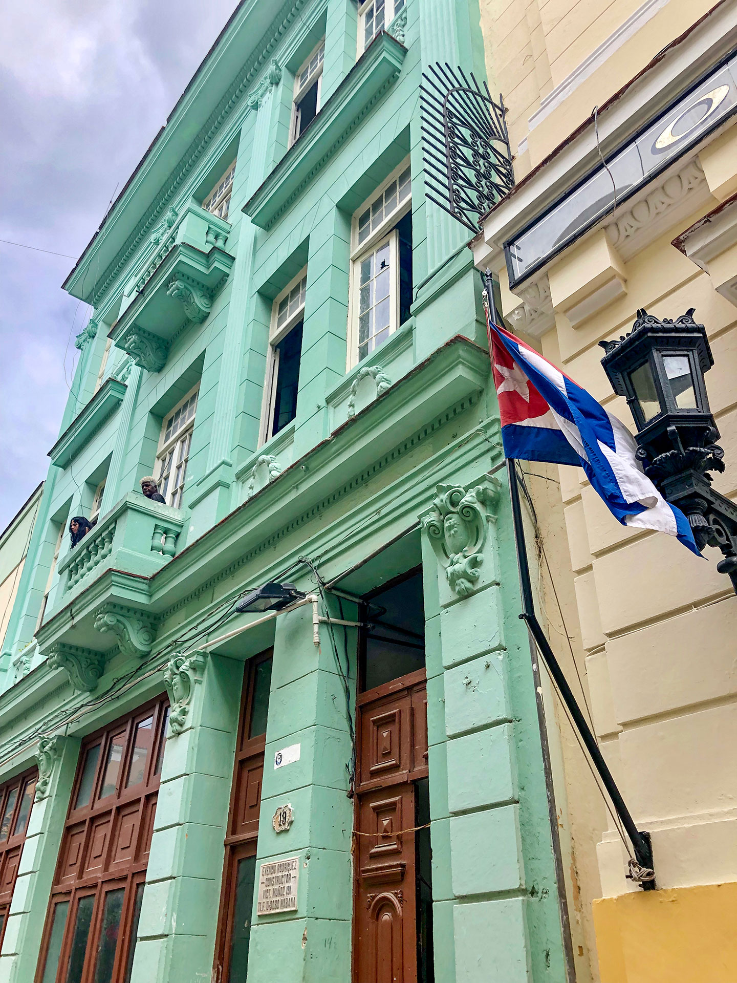 Colorful building with the cuban flag in Havana