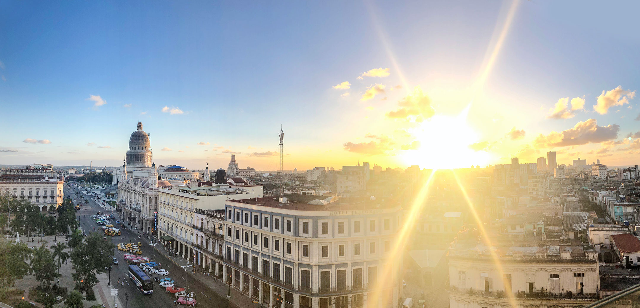 Panoramic of the Havana from the top at sunset on a sunny day with the capitol at the end